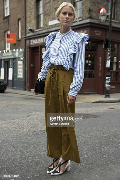 Red magazine editor Sophie Hooper wears shirt by HM COS trousers and Massimo Dutti bag on day 2 of London Womens Fashion Week Spring/Summer 2016 on...