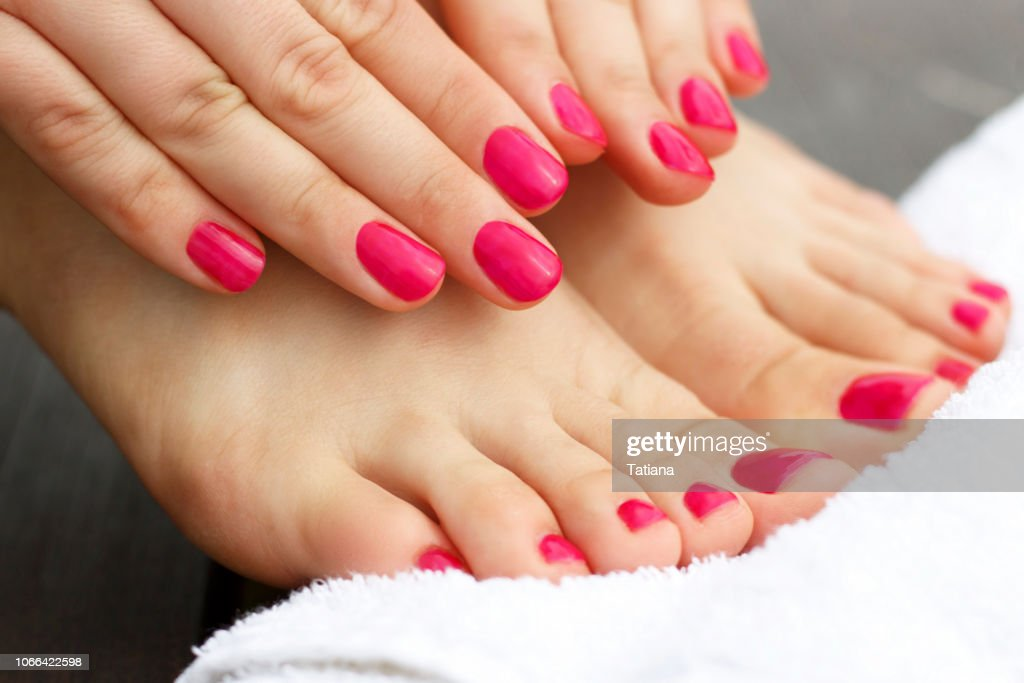 Red manicure and pedicure : Stock Photo