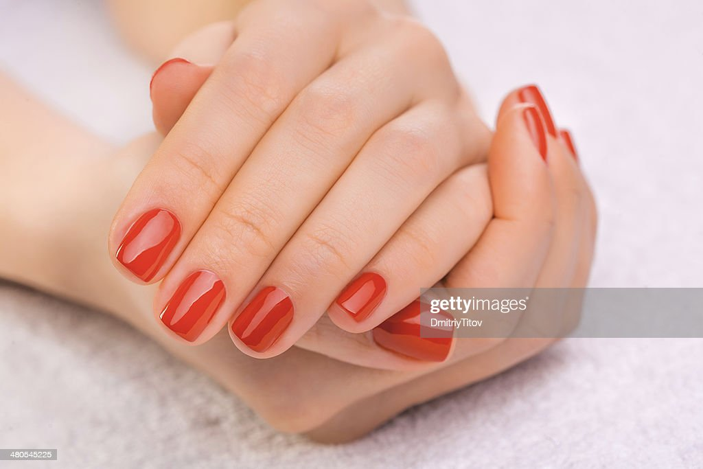 red manicure on the white towel : Stock Photo