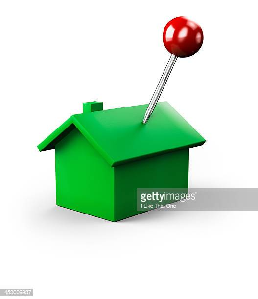 Red map pin stuck into a green house icon
