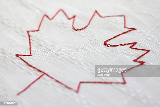Red maple leaf hand stitched outline