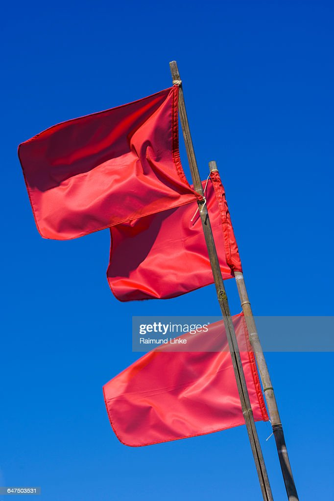 Red Marking Flags For Fishing Nets Photo - Getty Images