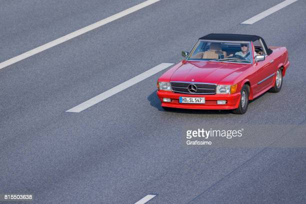 red mercedes-benz 300 sl on german multiple lane highway - mercedes benz stock pictures, royalty-free photos & images