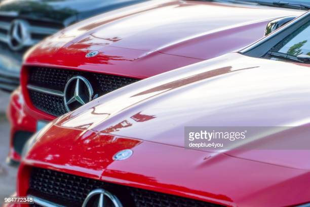 red mercedes-benz vehicles at a public dealership - mercedes benz stock pictures, royalty-free photos & images