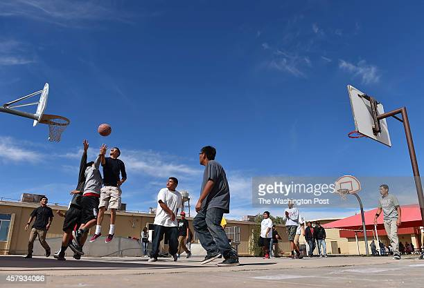 Red Mesa High School students are seen playing basketball at Red Mesa High School on October 15 2014 in Red Mesa AZ The Red Mesa Redskins is a small...