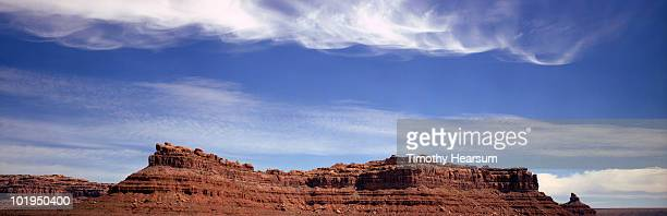 red mesa with swirling clouds above - timothy hearsum stockfoto's en -beelden