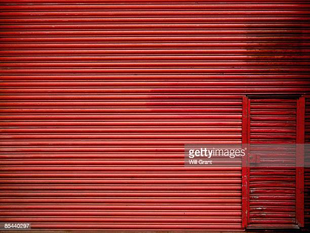 red metal corrugated door - corrugated iron stock photos and pictures
