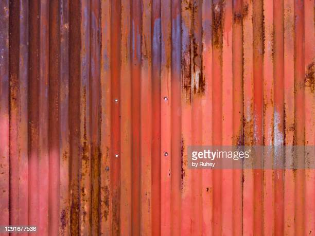 red metal door background with retro style forming geometric pattern - weathered stock pictures, royalty-free photos & images