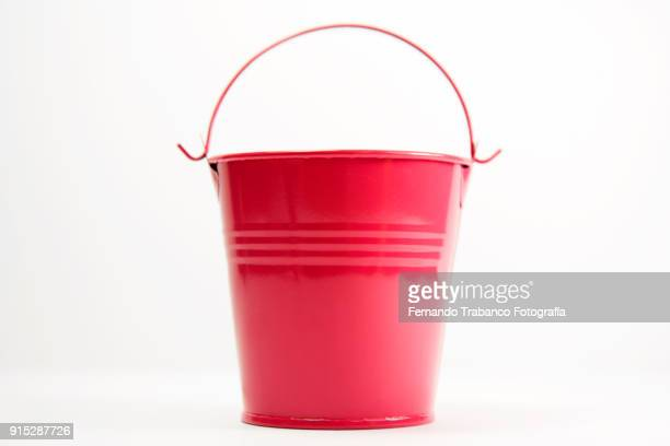 red metal pail - bucket stock pictures, royalty-free photos & images
