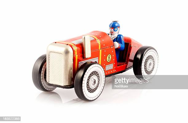 Red metal toy car with driver