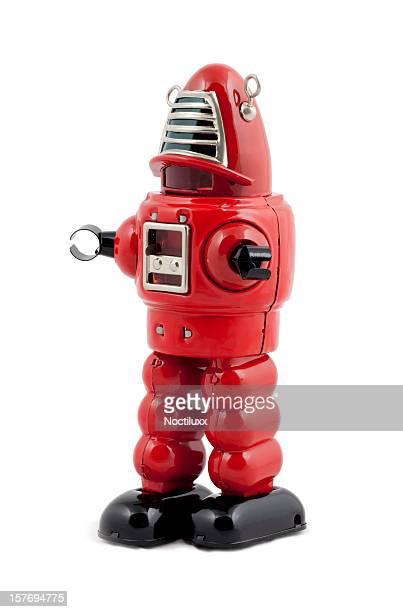robot métal rouge miniature isolé