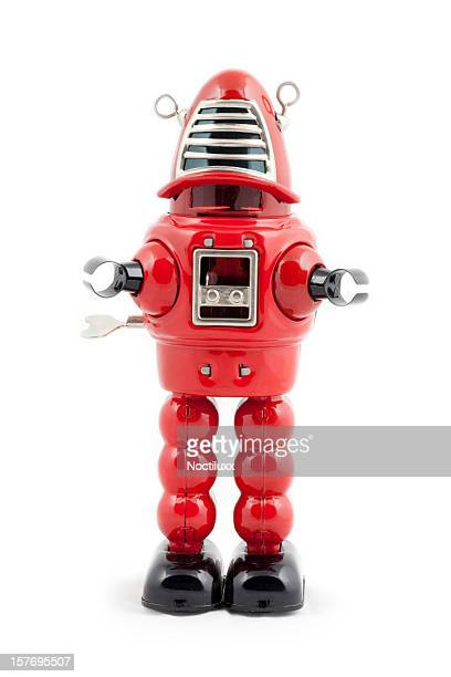 red metal toy robot - metallic suit stock photos and pictures