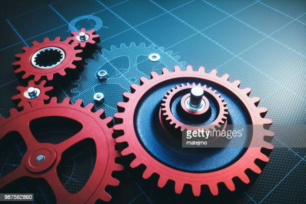 red metallic gears on a grid with hatched schematics - gear stock pictures, royalty-free photos & images