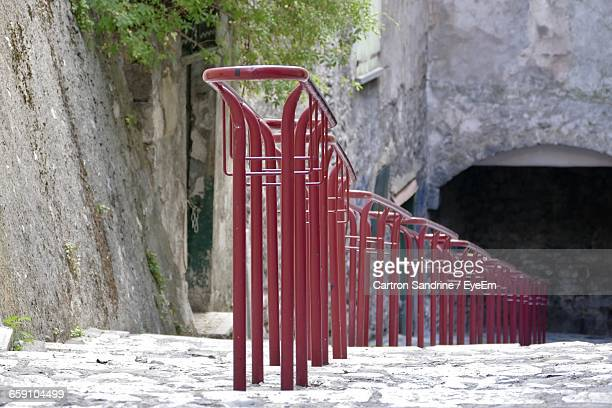 red metallic railing on footpath - alpes de haute provence stockfoto's en -beelden
