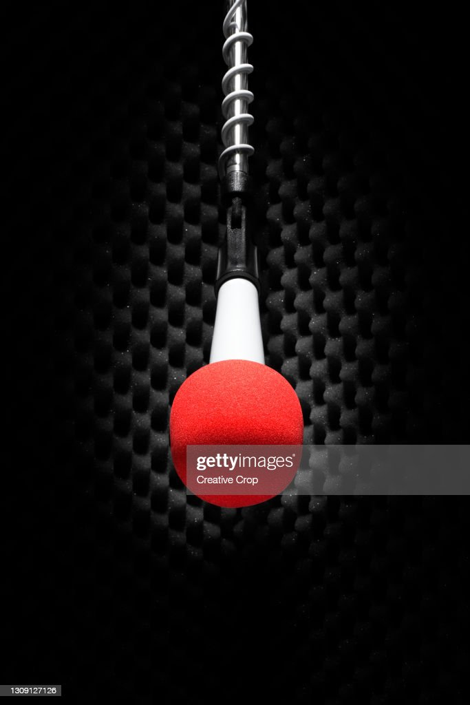A red microphone on a stand : Stock Photo