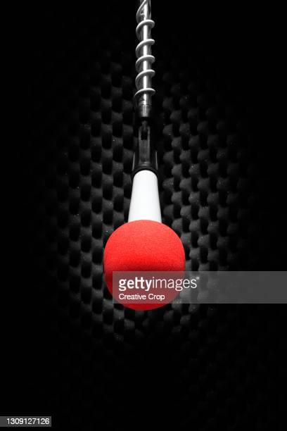 a red microphone on a stand - microzoa stock pictures, royalty-free photos & images