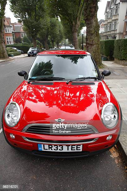 Red Mini One car parked in a parking bay in a London street England United Kingdom