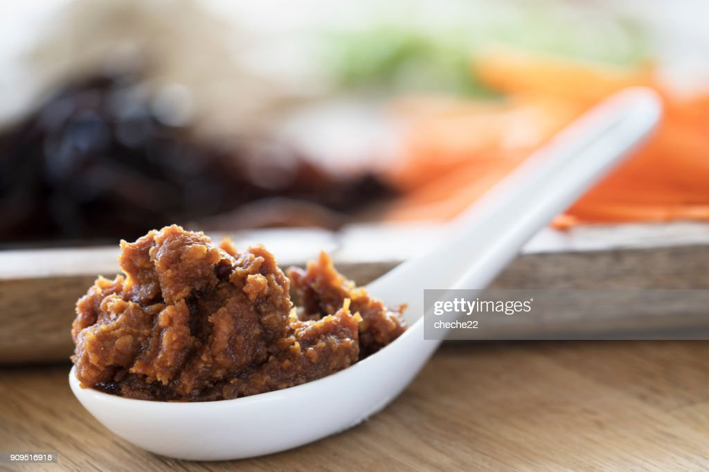 Red Miso in White Soup Spoon : Stock Photo