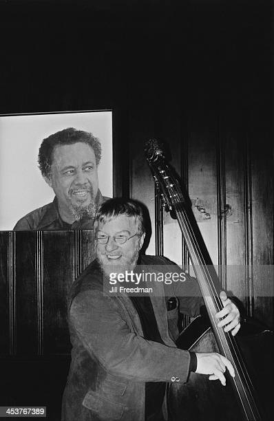 Red Mitchell peforms on stage at 'Bradley's' Greenwich Village New York City circa 1978 Behind Mitchell is a poster of Charles Mingus