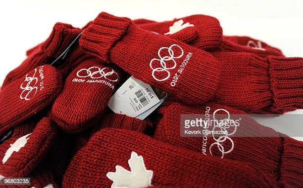 Red mittens as displayed in this photo illustration with the Olympic Rings and the Canadian Maple leaf have become a very popular items at these...