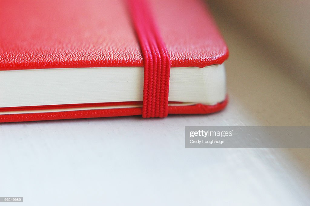 Red moleskine notebook : Stock Photo