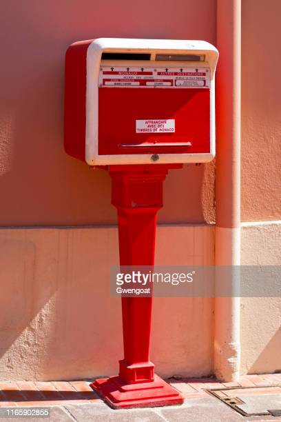 red monegasque public mailbox - monaco stock pictures, royalty-free photos & images