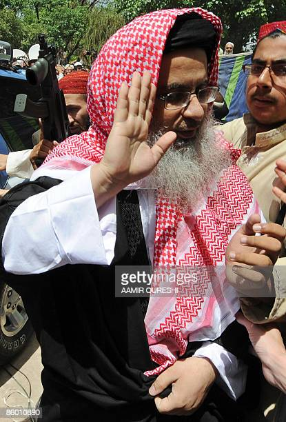 Red Mosque chief cleric Maulana Abdul Aziz gestures as he arrives at the Red Mosque to lead Friday prayers after his release in Islamabad on April...