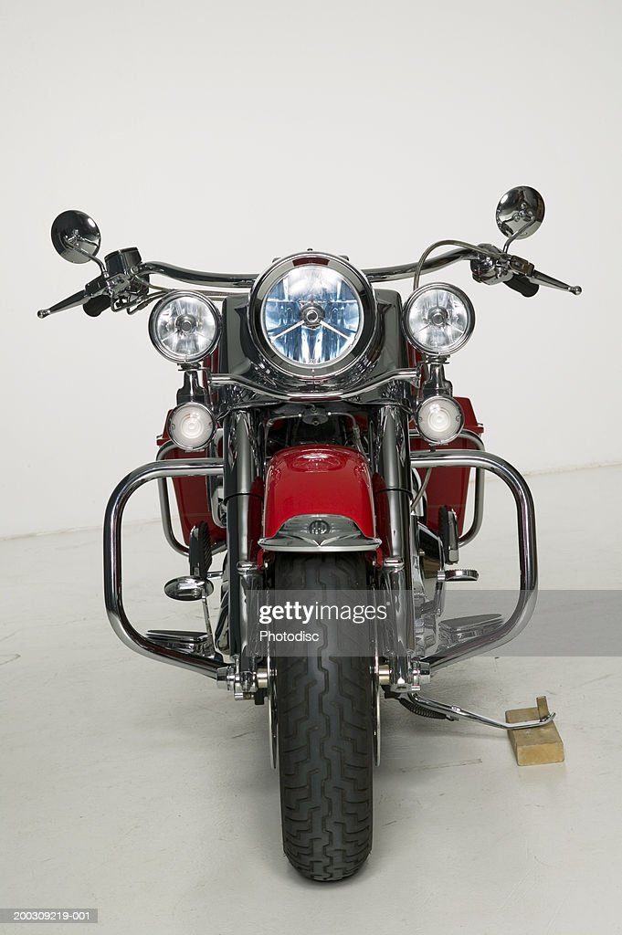 Red motorcycle parked in studio : Stock Photo