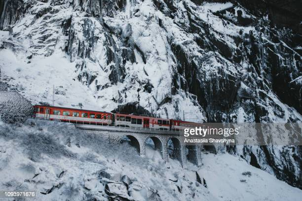 red mountain train in swiss alps - mere noel stock pictures, royalty-free photos & images