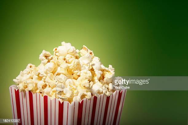 red movie popcorn box on green