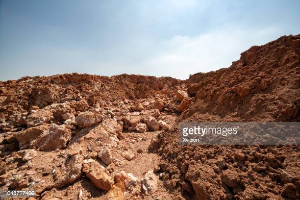 red mud barren land wide open - rock stock pictures, royalty-free photos & images