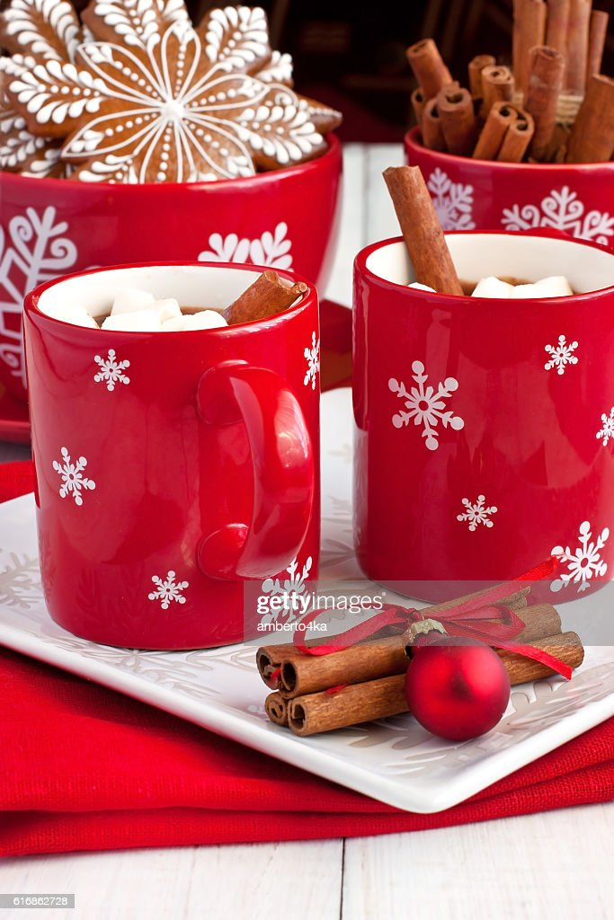 Red mug filled with hot chocolate and marshmallows : Stock Photo
