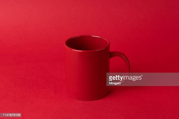 red mug on red - mug stock pictures, royalty-free photos & images