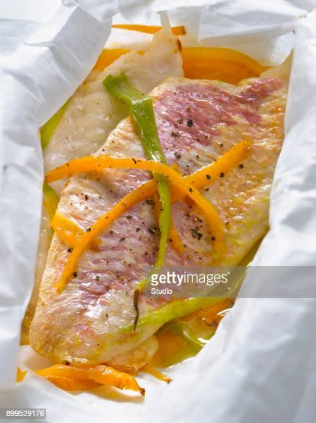 Red mullet with carrots and spring onions cooked in wax paper