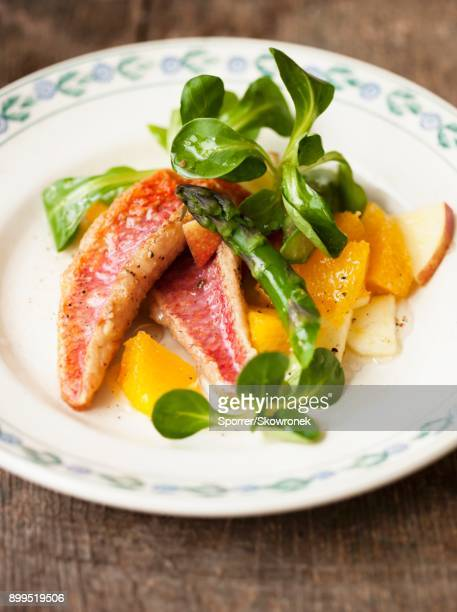 Red mullet with lambs lettuce, asparagus and orange and apple pieces