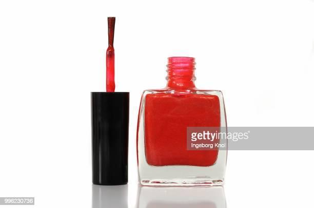 Red nail polish, nail polish bottle with brush