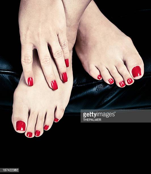 red nails - beautiful female feet stock photos and pictures