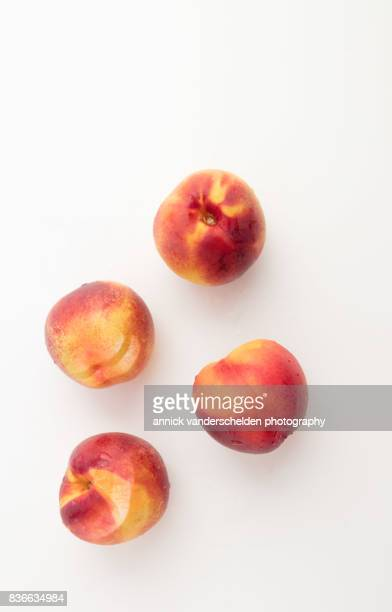 red nectarines. - peach stock photos and pictures