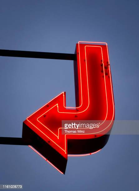 red neon arrow - usa stock pictures, royalty-free photos & images