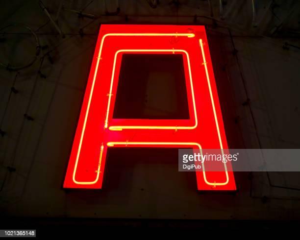 red neon capital letter 'a' in the night - lettera a foto e immagini stock