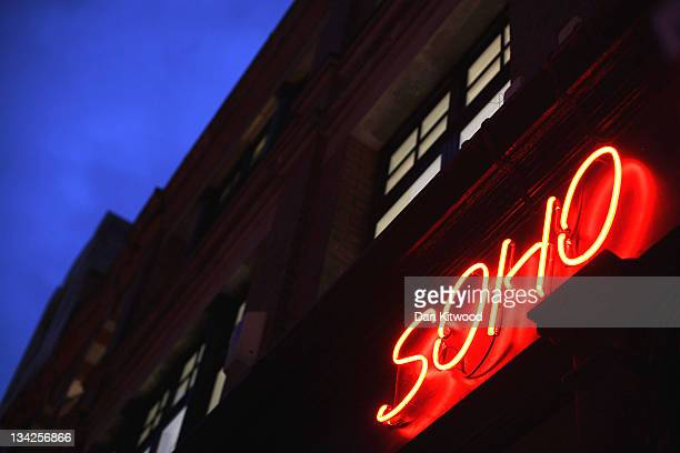 A red neon light illuminates a shop in Soho on November 29 2011 in London England