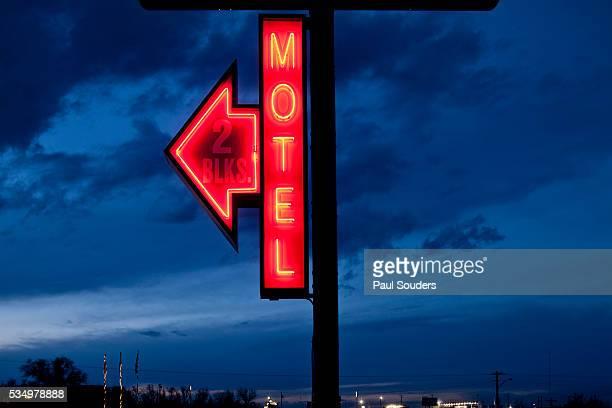 Red neon motel sign at dusk in North Dakota