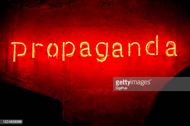 "red neon ""propaganda"" in the night - propaganda stock pictures, royalty-free photos & images"