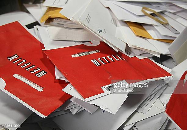 Red Netflix envelopes sit in a bin of mail at the US Post Office sort center March 30 2010 in San Francisco California Netflix announced September 19...