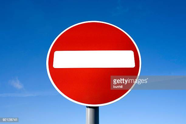 red no entry sign: do not enter against blue sky