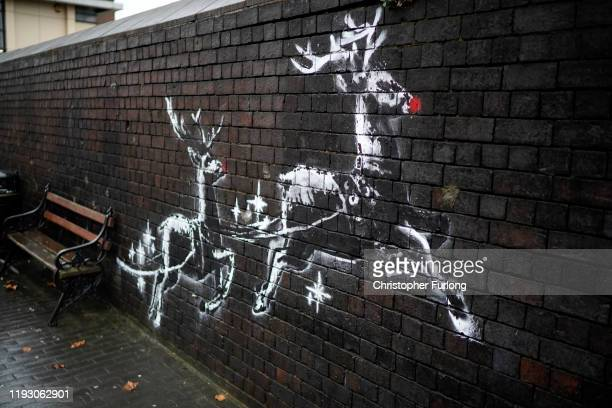 Red noses have appeared on Banksy's Birmingham homeless reindeer mural which has also been fenced off to protect the artwork on a railway bridge wall...