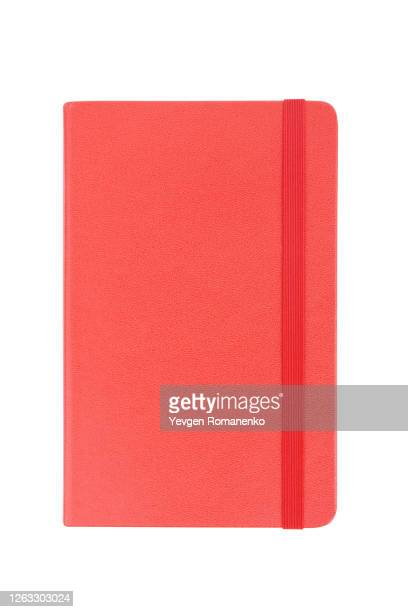 red note pad with rubber band isolated on white background - ゴム ストックフォトと画像