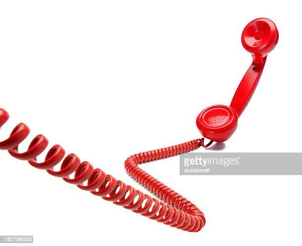 Rot altmodische Telefon auf weißem Hintergrund
