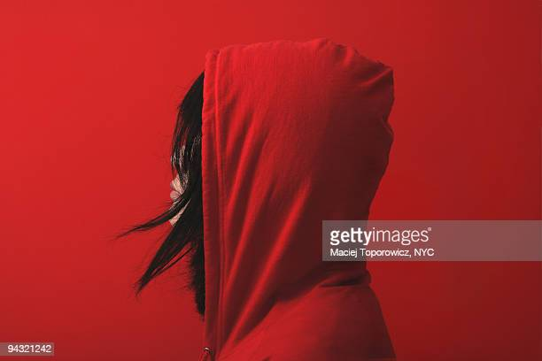 red on red - hooded shirt stock pictures, royalty-free photos & images