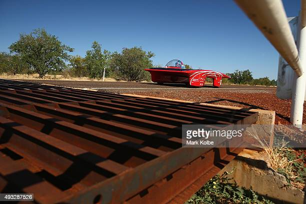Red One of Solar Team Twente Netherlands crosses a cattle grid as it races in the Challenger Class into Elliott during day two of the 2015 World...